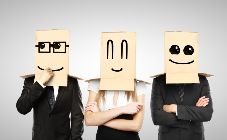 reproach: men and woman with smiling box on head Stock Photo