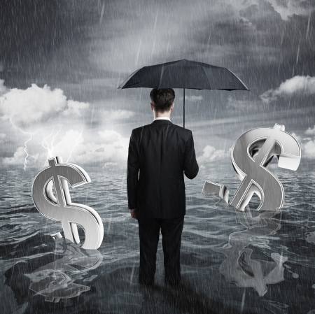 is raining: businessman with umbrella business concept Stock Photo