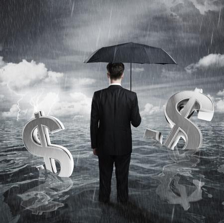 raining: hombre de negocios con el concepto global de negocio