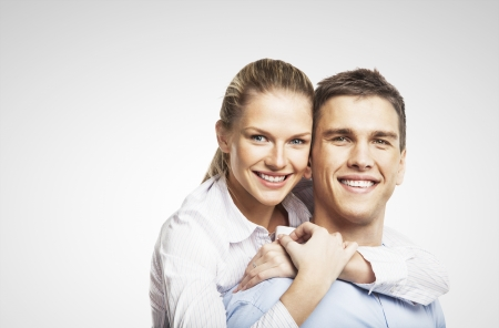 2 people: smiling man and woman on white background