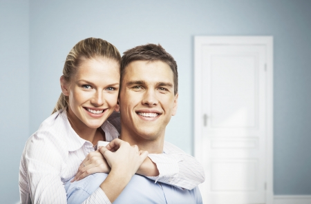 smiling man and woman in blue room Stock Photo - 16985837