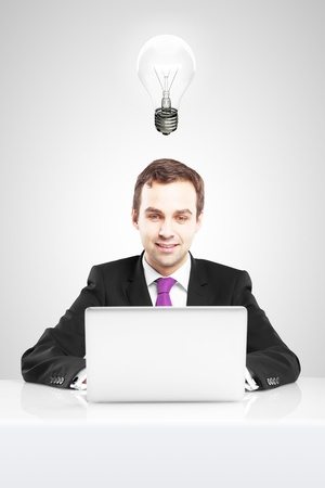 businessman holding laptop and lamp photo