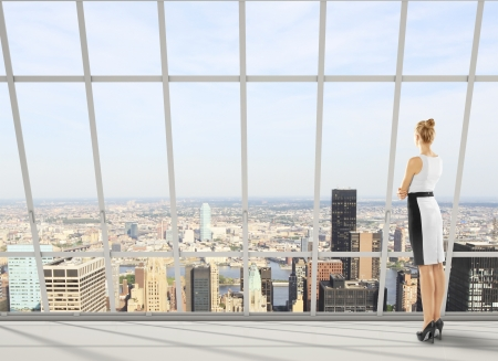 woman boss: businesswoman in office and city views Stock Photo