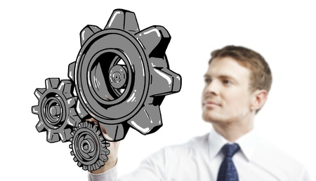 man drawing gears on white background Stock Photo - 17250324