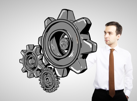 businessman drawing gears on white background Stock Photo - 17250363