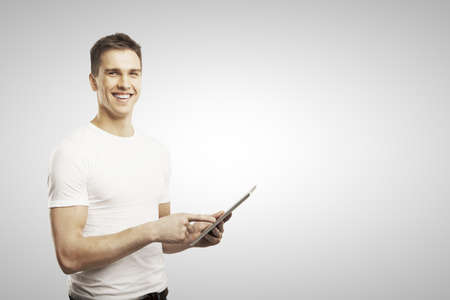 man holding tablet  on white background Stock Photo - 17250355