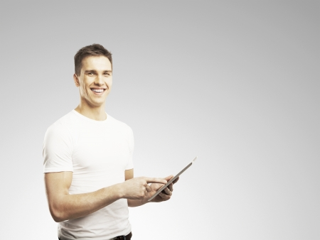 man holding touch pad on gray background Stock Photo - 17250343
