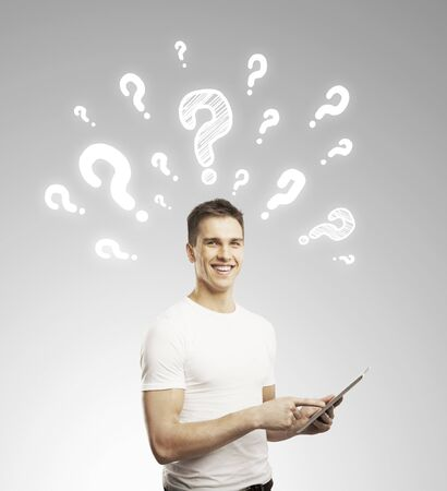 man holding touch pad and questions mark Stock Photo - 17250384