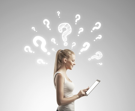 beautiful woman with tablet computer and  questions mark Stock Photo - 17256168