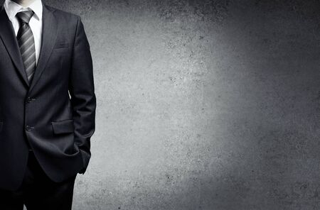 tuxedo: businessman in suit on a concrete background