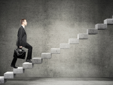 difficult journey: Businessman stepping up a staircase