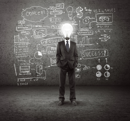 bulb headed man and business plan concept on wall Stock Photo
