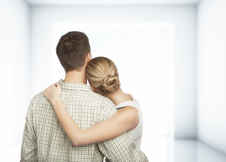 young couple in white room Stock Photo - 17281387