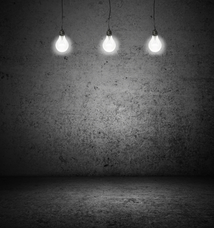 cracked concrete frame: dark room with three lightbulbs