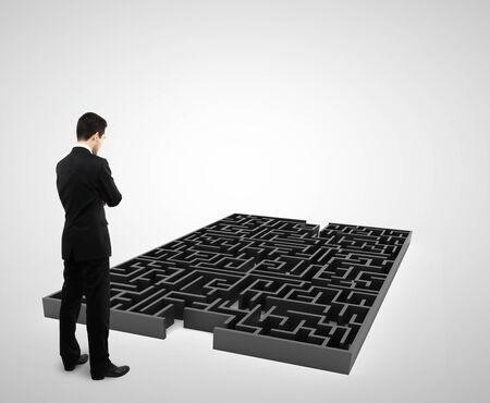 businessman standing and looking to black labyrinth photo