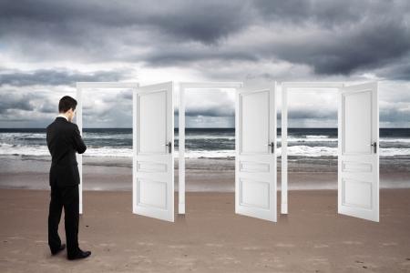 man standing on beach and opened doors Stock Photo - 17281361