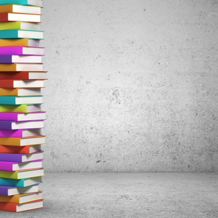 book background: stack of books on concrete background