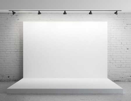 White backdrop in room with grey paint on wall Stock Photo