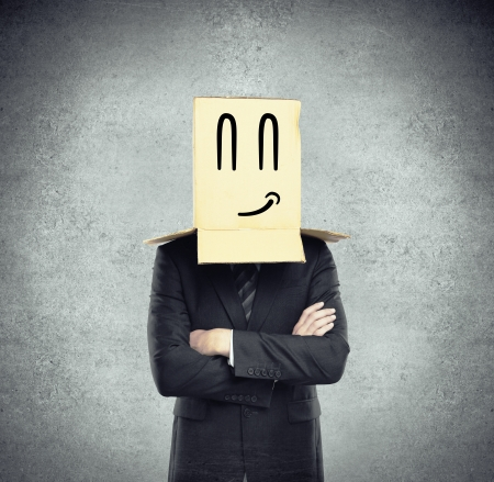 man with a box on head with smile Stock Photo - 17414911