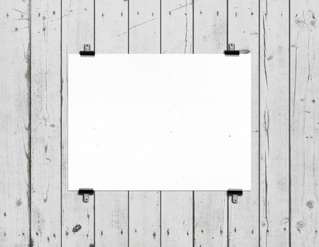white poster on wooden wall photo