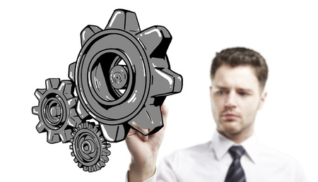 businessman drawing gears on white background Stock Photo - 17414980