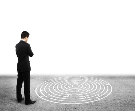 businessman standing and looking to labyrinth photo
