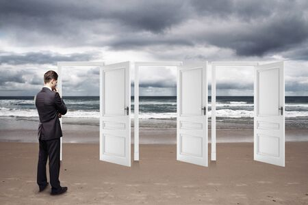 man standing on beach and opened doors photo