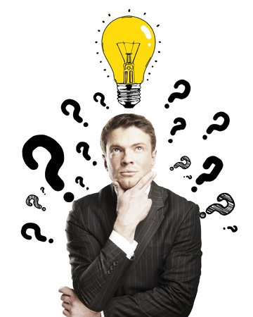 businessman with question mark and lamp on a white background photo