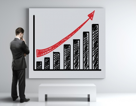 businessman looking at poster with growth chart photo