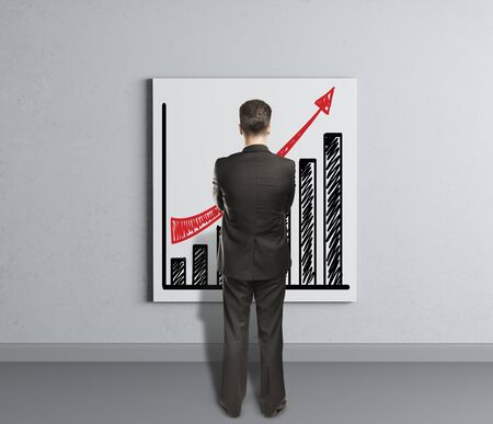 businessman looking at placard with growth of chart photo
