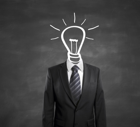 male costume: businessman with lamp-head on black background