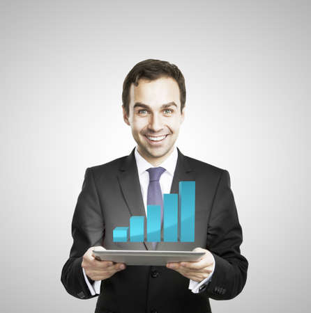 businessman hold tablet with growth chart photo