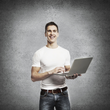 smiling young men with laptop photo