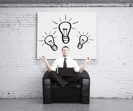 man meditating in brick room, idea concept Stock Photo - 17420283