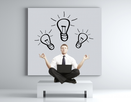 businessman meditating in room, idea concept Stock Photo - 17420238