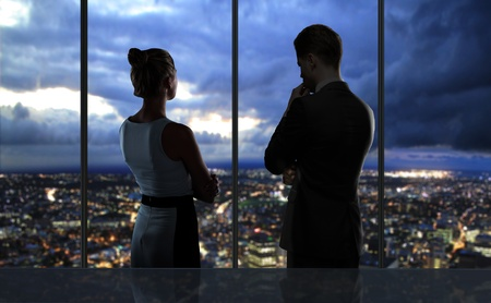 girls night: man and wooman looking at night city Stock Photo