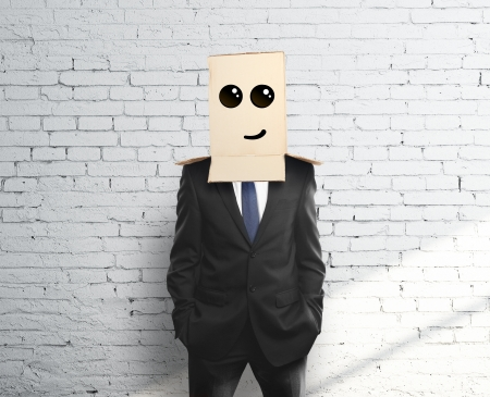 man with a box on head with smile photo