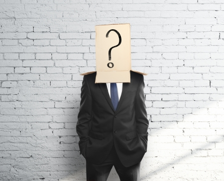 man with a box on head with question mark photo