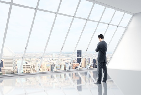 businessman thinking in white loft office Stock Photo - 17538918