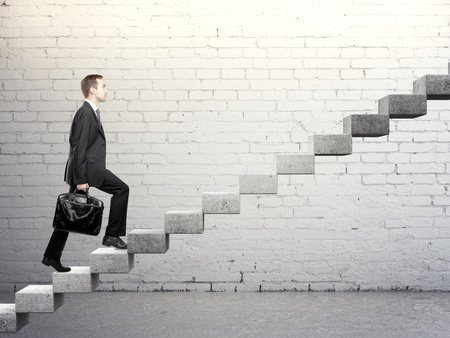 Businessman stepping up a career stair photo