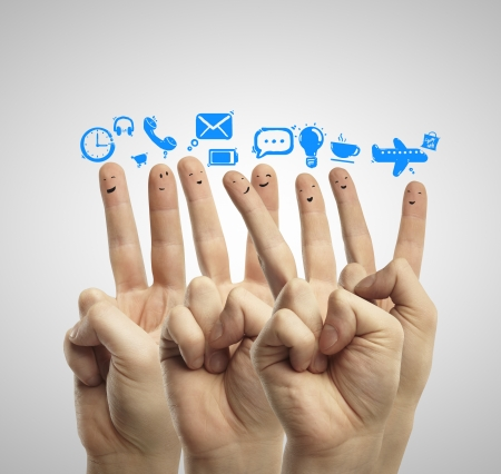 creative communication: happy group of finger smileys with social media icons