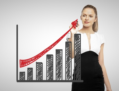 businesswoman drawing business graph with red arrow photo