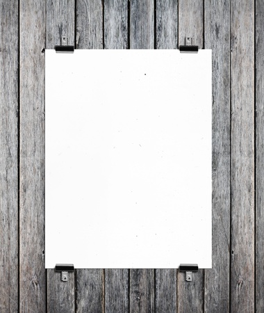 one sheet: white poster on a wood wall