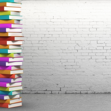 bookstore: stack of colorful books on brick background