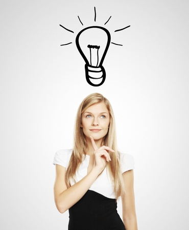 businesswoman with lightbulb over head Stock Photo - 17539107