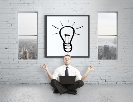 businessman meditating in loft, idea concept Stock Photo - 17538704