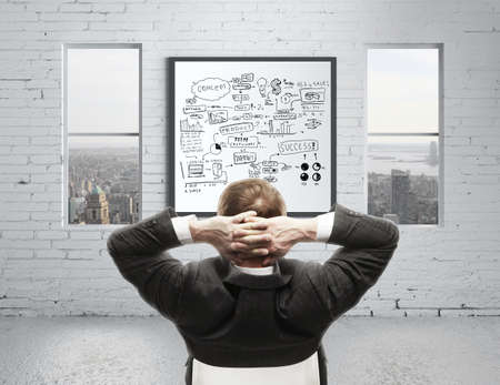 businessman in office and graphs concept photo