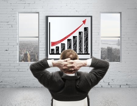 man looking at growth chart on poster photo