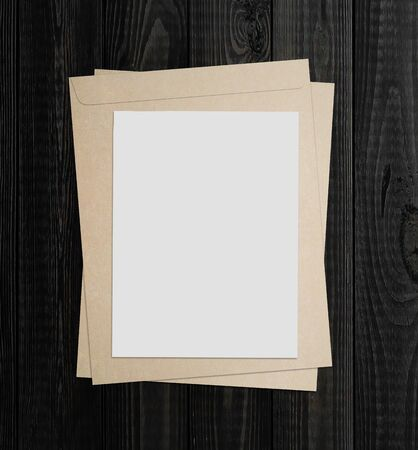 blank white poster on a wood wall photo