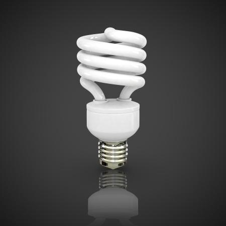 Energy saving fluorescent lightbulb on black background Stock Photo - 17686602